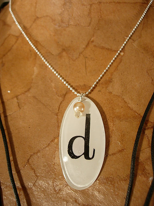 Monogrammed jewelry made using eyeglasses