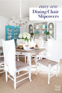 dining room with white chairs and white DIY made slipcovers