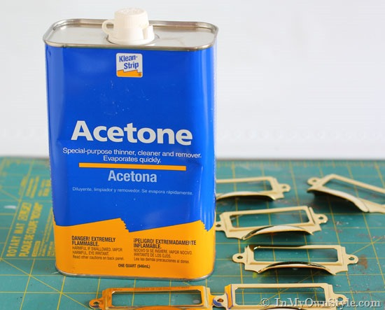 Use acetone to remove lacquer from metal
