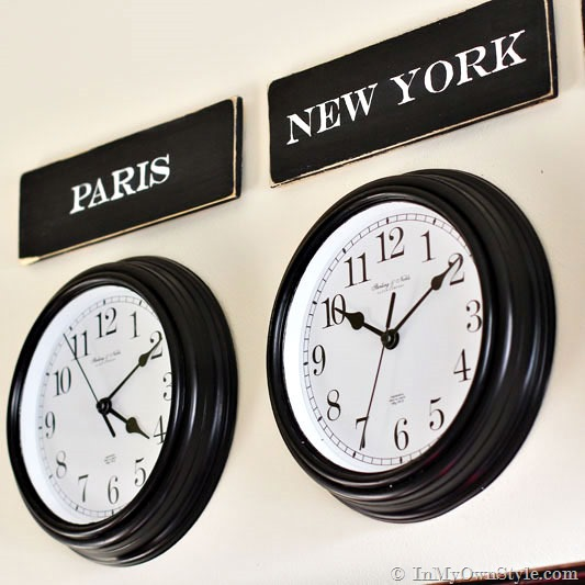 Paris and New York signs above wall clocks