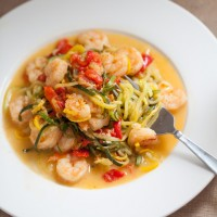 Garlic Shrimp zoodle recipe that uses zucchini and yellow squash. You won't even miss the pasta.