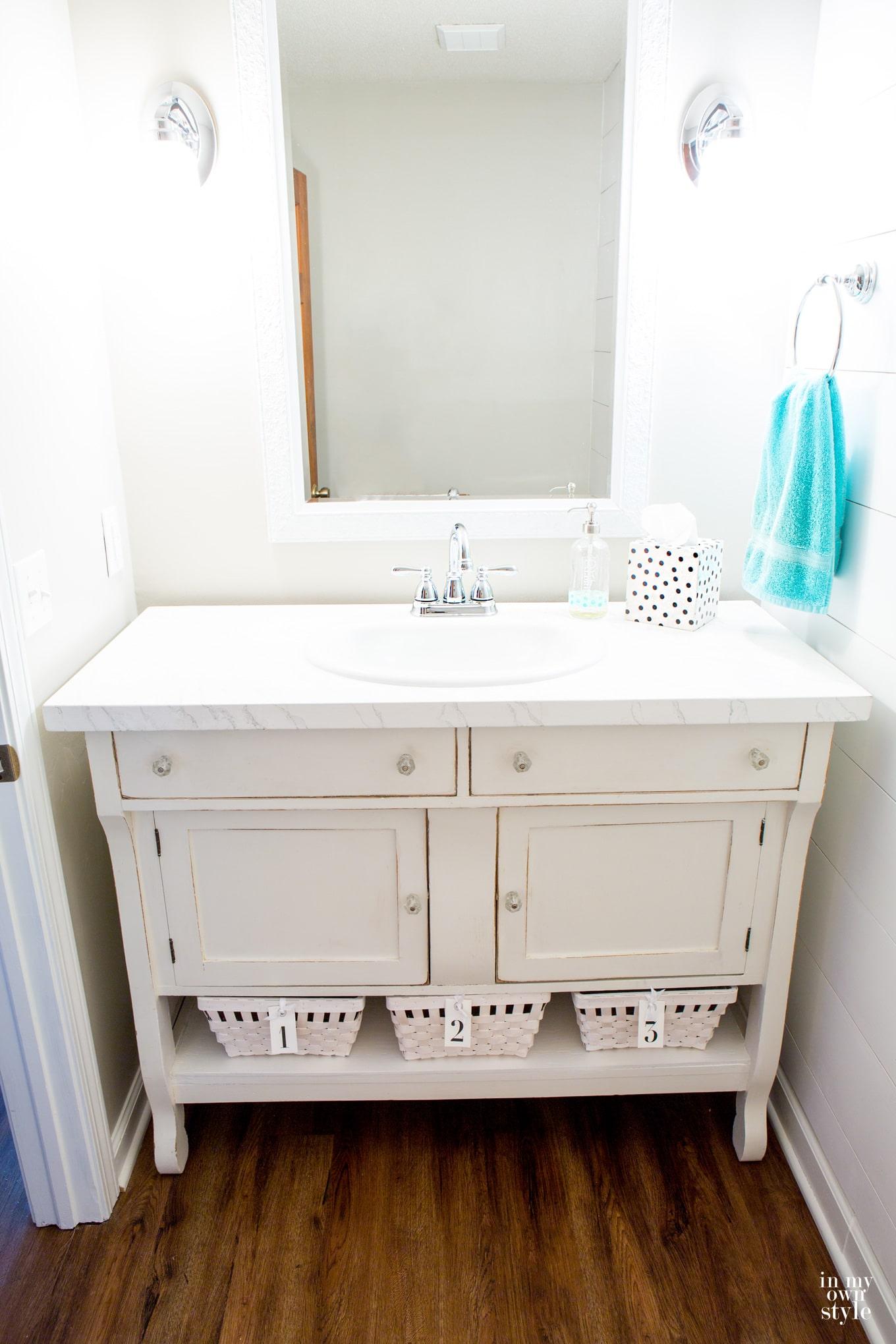 Repurposed dresser sideboard into a sink vanity