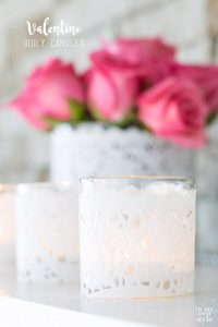 Valentine's decorating idea that can be done in 10 minutes. Make these sweet doily covered votive holders to light your home or table.