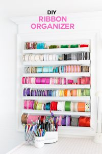Ribbon organizer to make for a craft room wall. It is perfect for ribbon storage, but easily accessible for when needed to DIY and create.