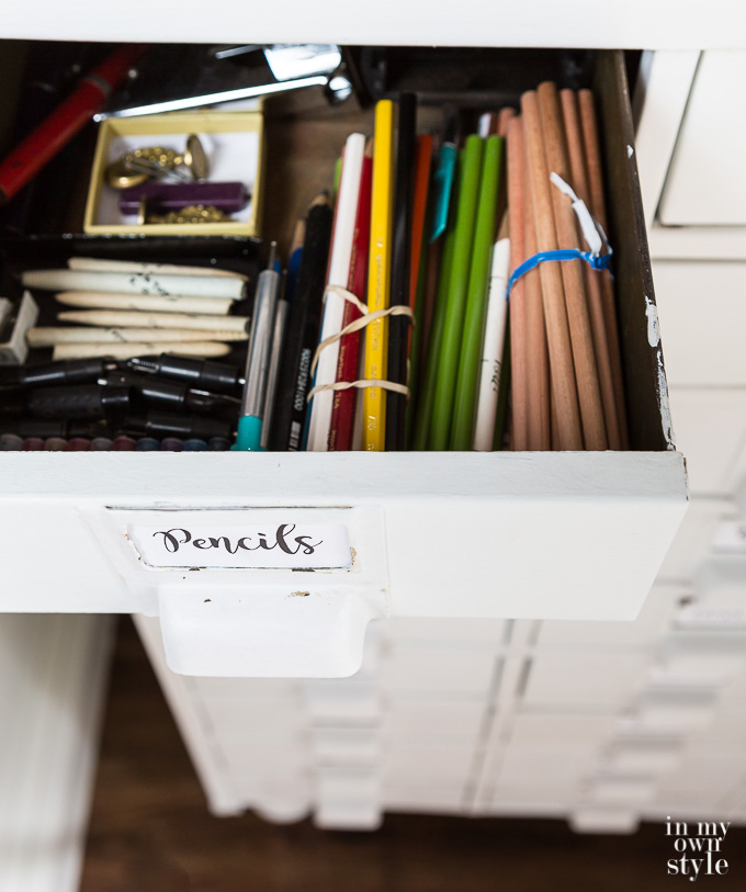 How to store and organize small items and supplies in a craft room.