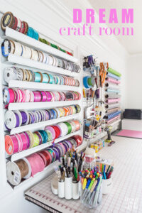 Craft room organization on a wall in a home craft room office