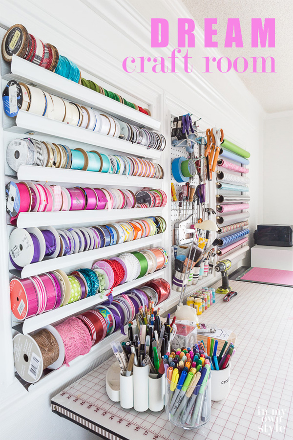 DIY made craft ribbon storage on the wall in a home craft room office.