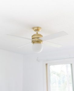 Pretty Hunter Hepburn Ceiling fan. Gold with white blades