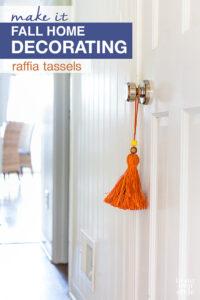 Orange raffia tassel hanging on a white door for fall decorating.