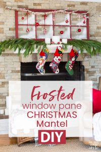 Christmas decorated mantel using an old red window sash and ornaments