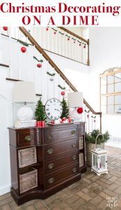 Christmas decorating ideas that are affordable, fast, and easy to do using garland ties. #Christmas #ChristmasDecorating #BudgetChristmas #ChristmasStaircase #HolidayFoyerDecor