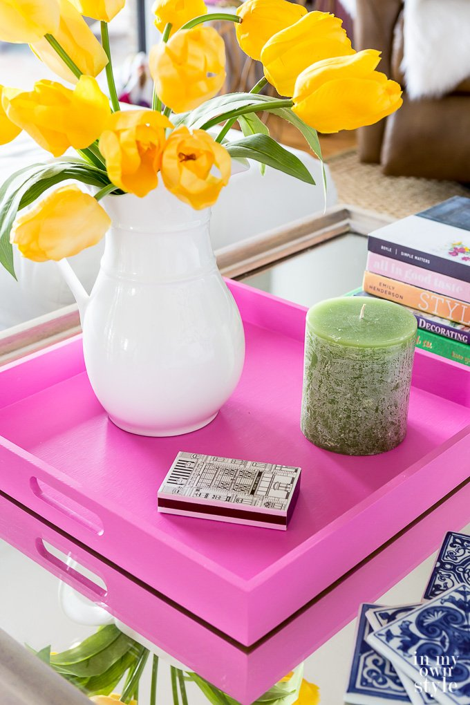 spring decorating on coffee table with pink wooden tray