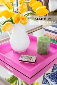 Coffee table styling idea using a tray. How to paint a tray to coordinate with a room's decor. Pink painted decorative tray.