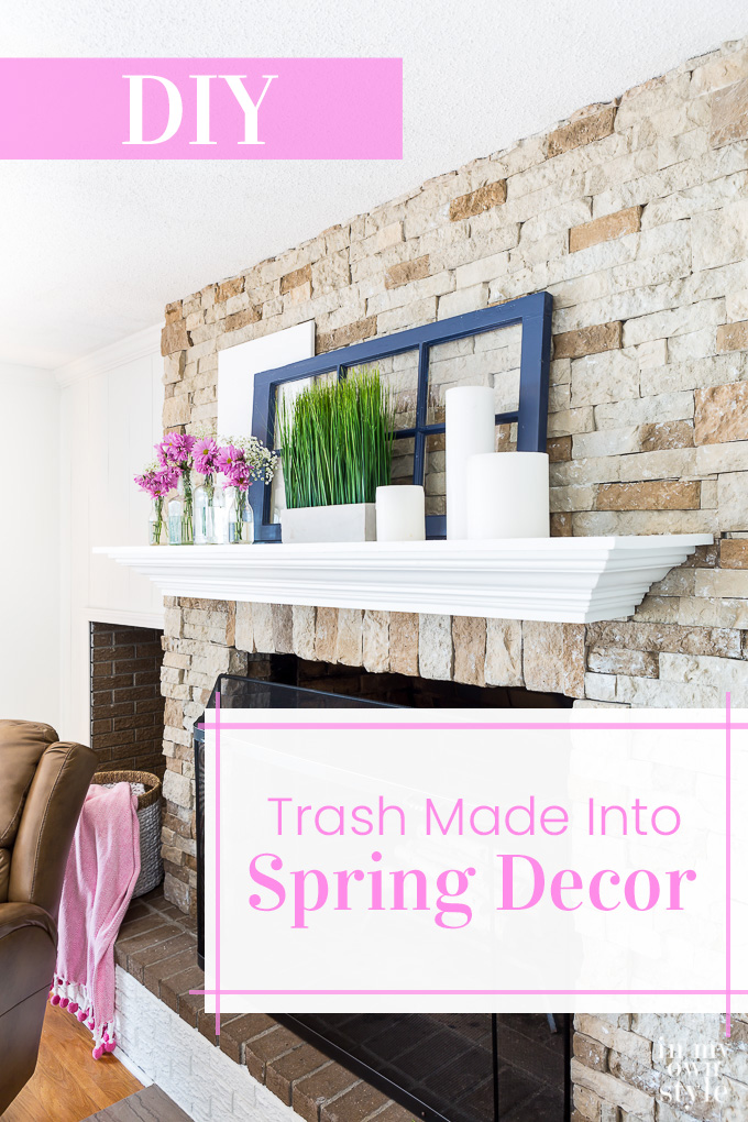 Stone fireplace and white mantel with pink and blue spring decor