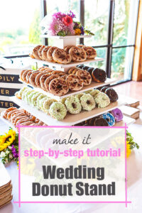 DIY wood donut stand on wedding reception table