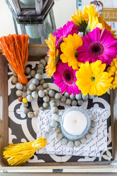 How to style a table tray for fall decorating raffia tassels