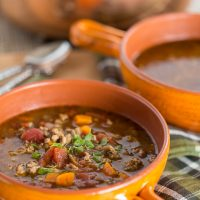 Sausage and Lentil Soup in orange bowl