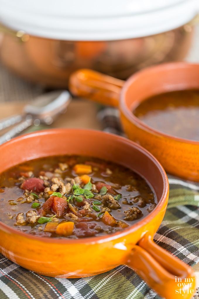 Sausage and Lentil Soup in orange bowl