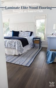 After photo showing how new wood laminate flooring looks in blue and white bedroom