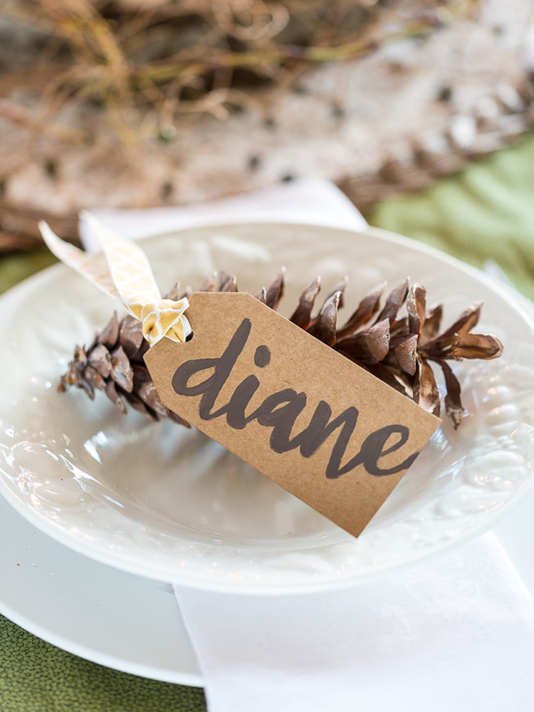 Brown Kraft paper place card on white plate for Thanksgiving table setting