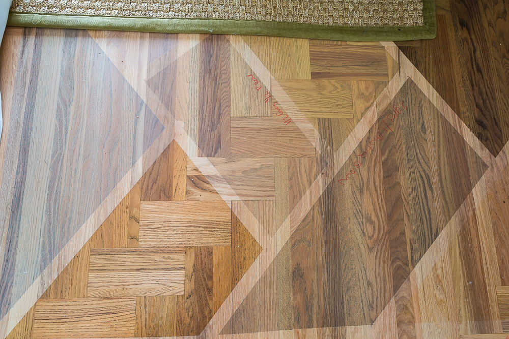 Most popular wood stain colors being tested on a just sanded hardwood floor to be refinished