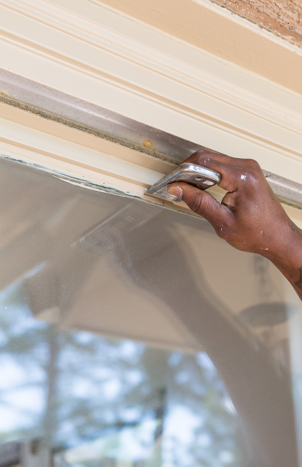 How to remove paint from glass on a door or window