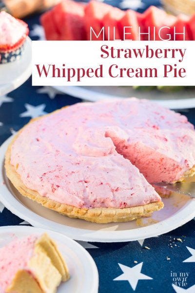 A Strawberry Whipped Cream pie with one slice cut out.