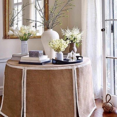 Brown and white linen covered table in foyer