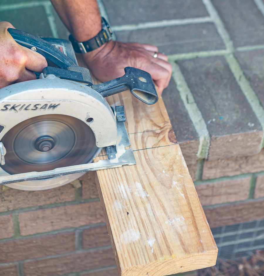cutting a block from a 2 x 6 wood board