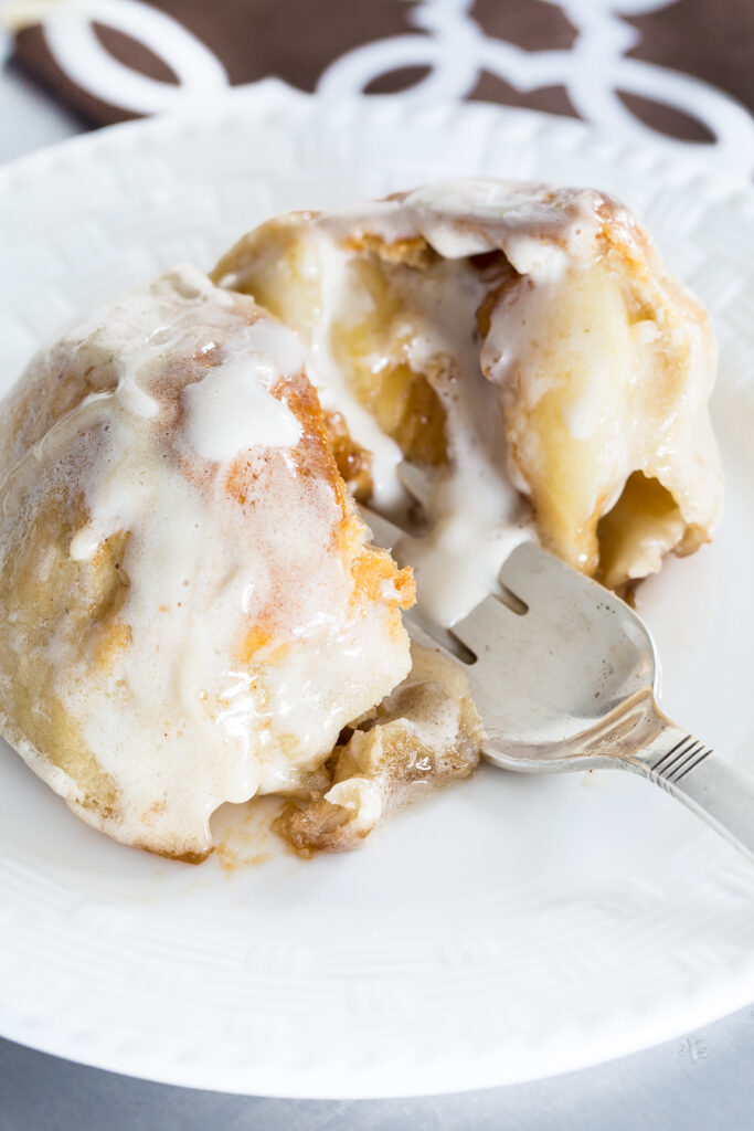 Breaking apart an Apple Cannonball baked apple with a fork