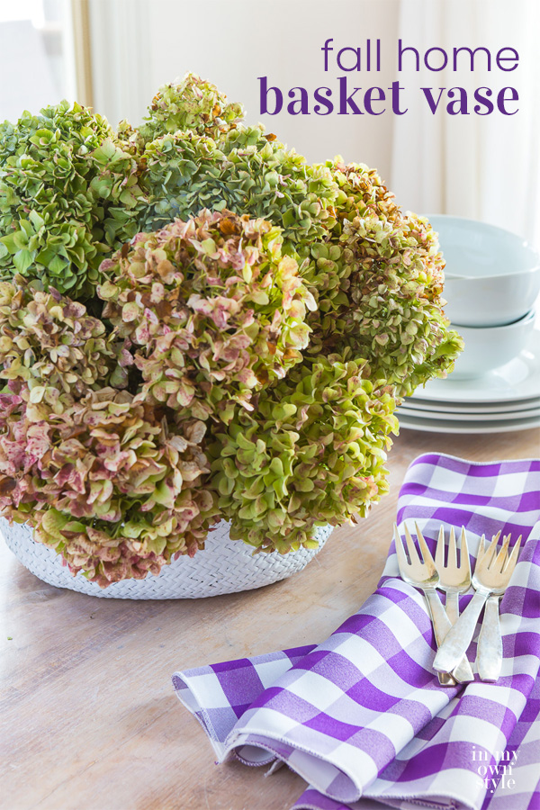 Collapsible Basket on table filled with dried hydrangeas.