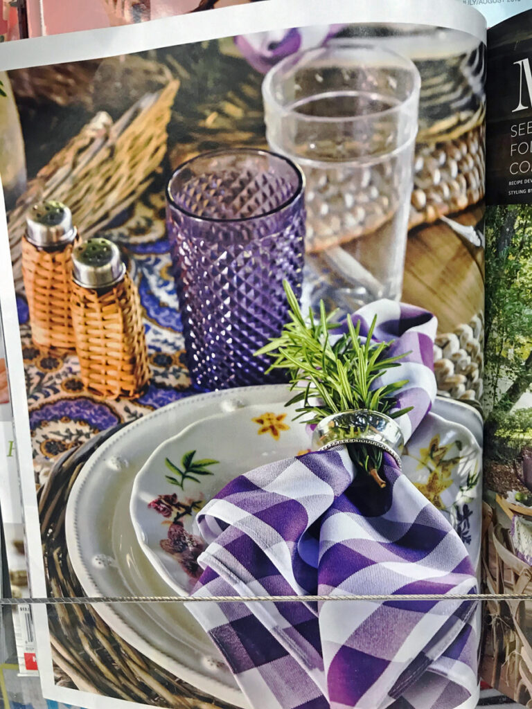 Fall table setting with baskets and purple and white checked napkins