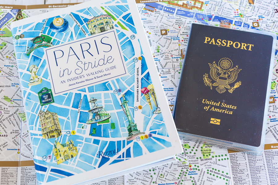 Paris in Stride Guidebook and US Passport on open map of Paris