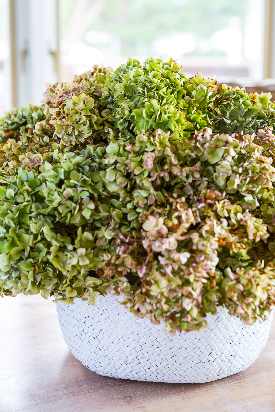 basket vase filled with dried hydrangeas for fall decor