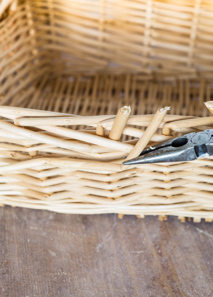 taking apart a thrift store basket so it can be used as decorative storage