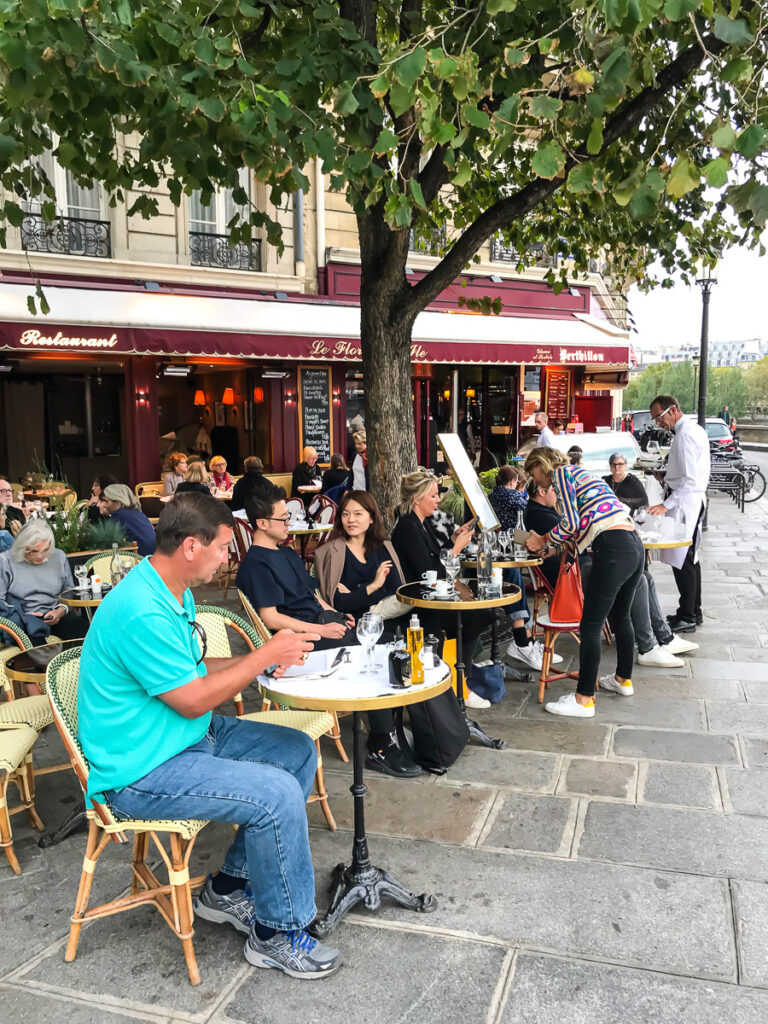 Eating dinner at a cafe along the Seine in Paris