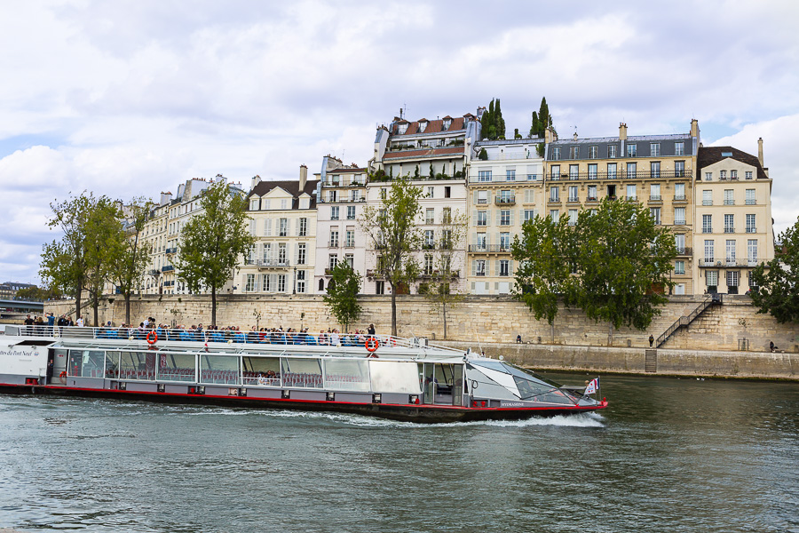 Tourist boat moving along the Seine in Paris