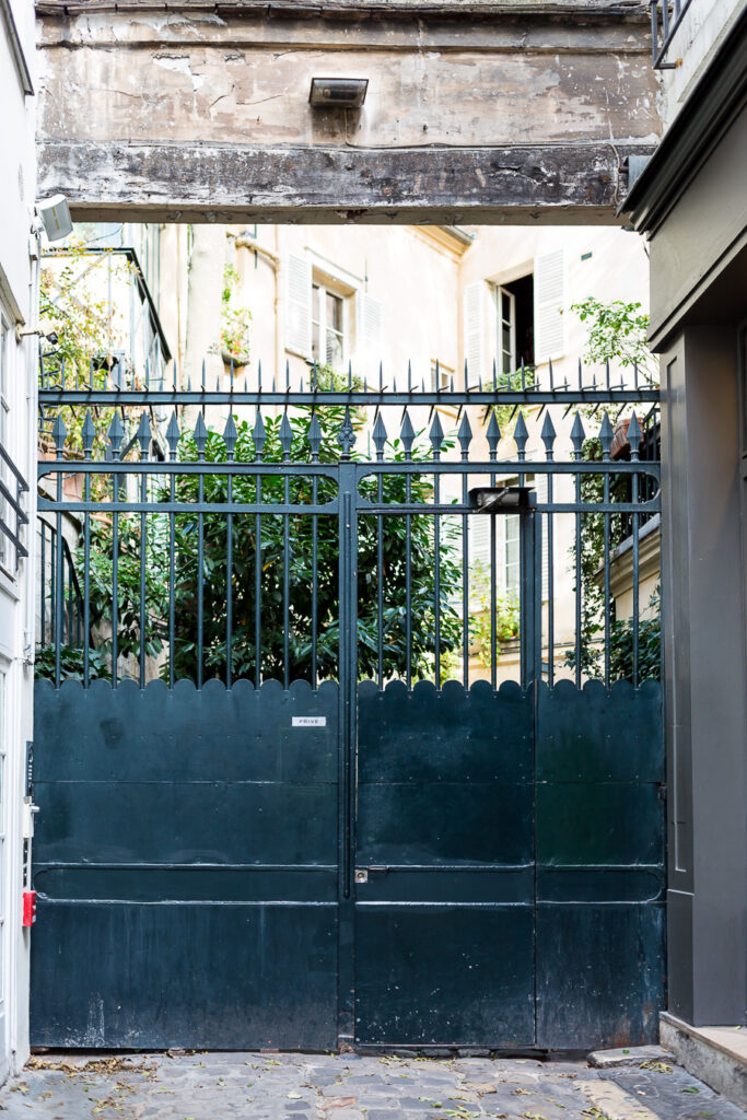 Gate to inner courtyard of an apartment building in Paris.