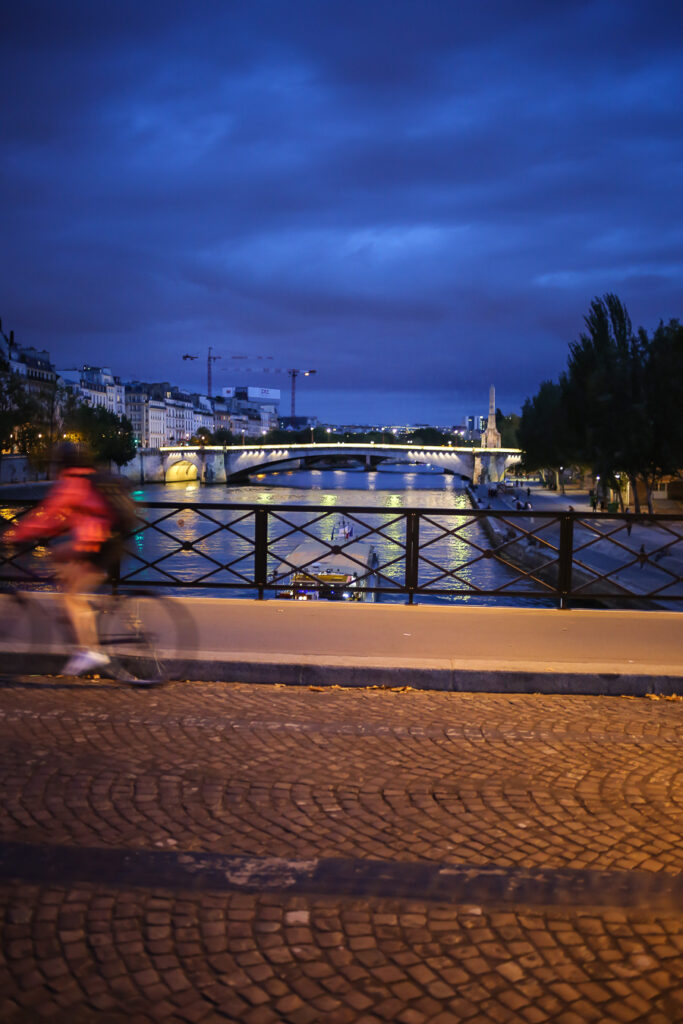Crossing a bridge on a bike tour over the Seine in Paris at night