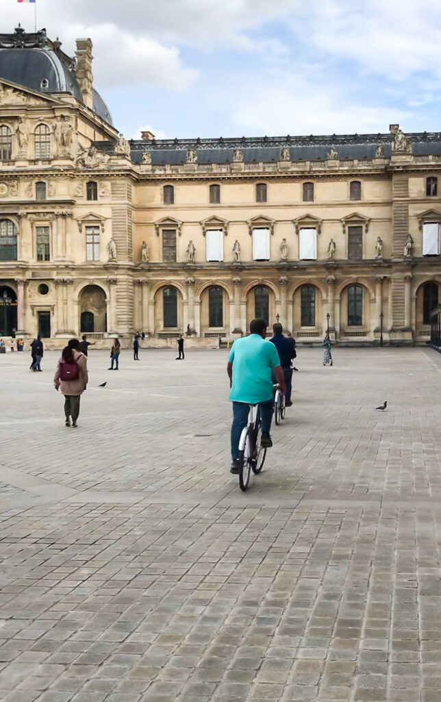 Bike tours in Paris that take you to  the courtyard of the Louvre in Paris France