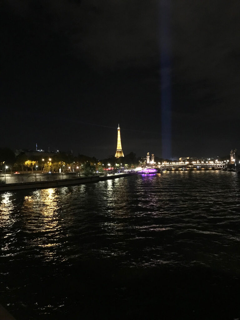 The Eiffel Tower at night viewed from the Right Bank of the Seine while on a Paris bike tour at night.