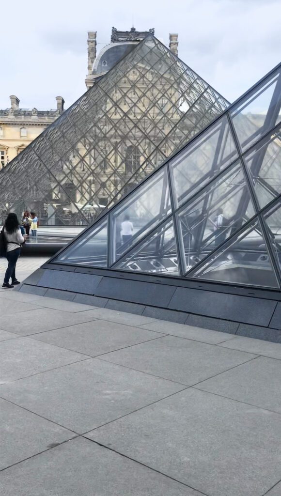 Bike tours in Paris that take you to  the courtyard of the Louvre in Paris France to see the glass pyramids.