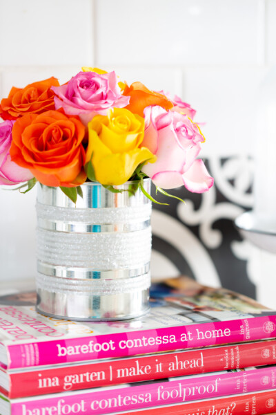 Kitchen counter styling ideas. Rainbow roses styled in a diy tin can vase on a kitchen counter.