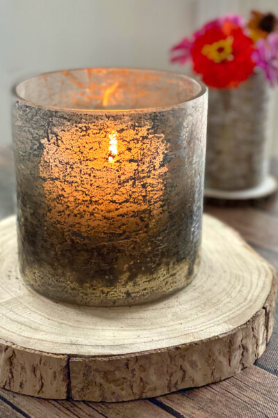 Candle in rustic glass candle holder