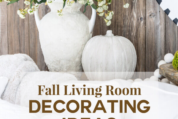 A stone vase and pumpkin on a sofa table with faux barn wood paneling behind them. Text says Fall Living Room Decorating Ideas