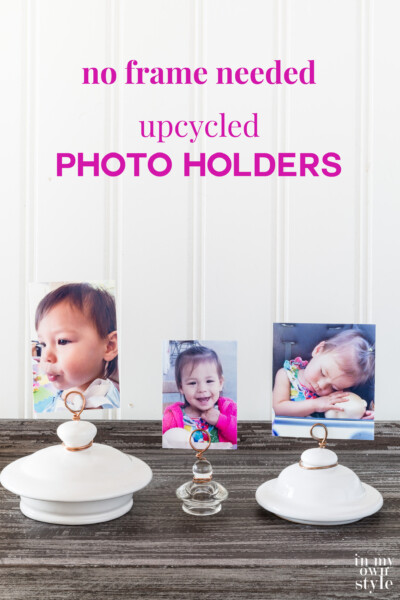 3 teapot lid and jar lid photo holders lined up on a table. Text overlay says no frame needed upcycled photo holders.