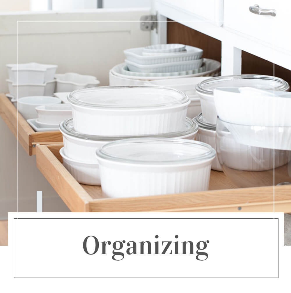 Home Organizing and decluttering ideas. Image shows a well organized kitchen cabinet.